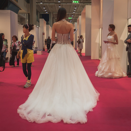 MILAN, ITALY - MAY 23: Model wears wedding dresses at Si Sposaitalia, ultimate exhibition for bridal and formal wear industry on MAY 23, 2014 in Milan.