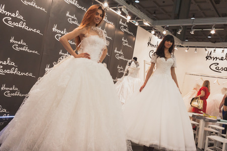 MILAN, ITALY - MAY 23: Models pose at Si Sposaitalia, ultimate exhibition for bridal and formal wear industry on MAY 23, 2014 in Milan.