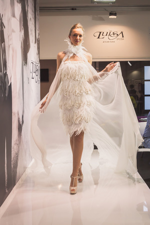 MILAN, ITALY - MAY 23: Model poses at Si Sposaitalia, ultimate exhibition for bridal and formal wear industry on MAY 23, 2014 in Milan.