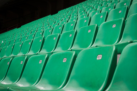 aloneness: Perspective of many empty green stadium seats