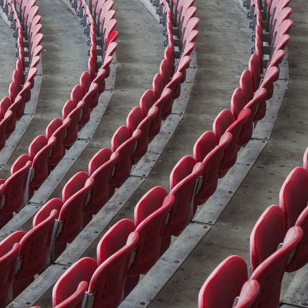 aloneness: Perspective of many empty red stadium seats