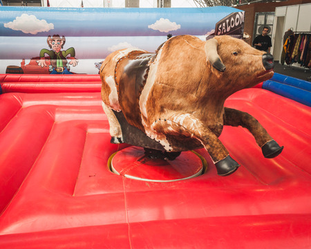 american music: MILAN, ITALY - JUNE 22  Mechanical bull on display at Rocking The Park, event dedicated to American music and lifestyle of the 40s, 50s and 60s on JUNE 22, 2014 in Milan
