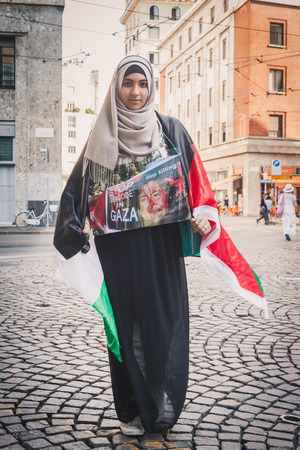 gaza: MILAN, ITALY - JULY 16: Girl protests against Gaza strip bombing in solidarity with Palestinians on JULY 16, 2014 in Milan.