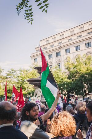 gaza: MILAN, ITALY - JULY 16: People gather and protest against Gaza strip bombing in solidarity with Palestinians on JULY 16, 2014 in Milan.