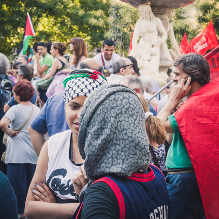 political rally: MILAN, ITALY - JULY 16: People gather and protest against Gaza strip bombing in solidarity with Palestinians on JULY 16, 2014 in Milan.