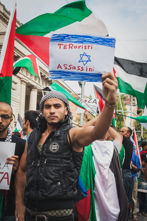 middle east crisis: MILAN, ITALY - JULY 26: People march and protest against Gaza strip bombing in solidarity with Palestinians on JULY 26, 2014 in Milan.