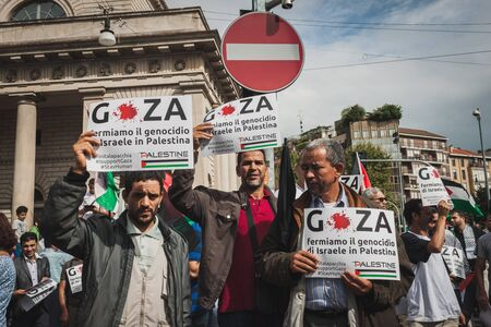 political rally: MILAN, ITALY - JULY 26: People march and protest against Gaza strip bombing in solidarity with Palestinians on JULY 26, 2014 in Milan.