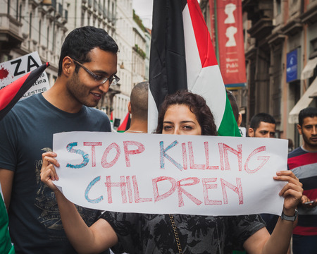 gaza: MILAN, ITALY - JULY 26: People march and protest against Gaza strip bombing in solidarity with Palestinians on JULY 26, 2014 in Milan.