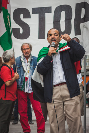against the war: MILAN, ITALY - JULY 30: People protest against Gaza strip bombing in solidarity with Palestinians on JULY 30, 2014 in Milan.