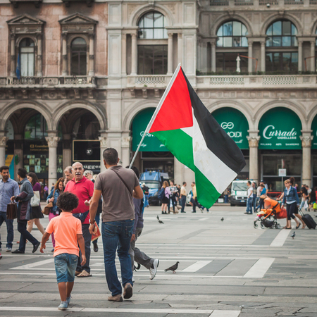 gaza: MILAN, ITALY - JULY 30: People protest against Gaza strip bombing in solidarity with Palestinians on JULY 30, 2014 in Milan.