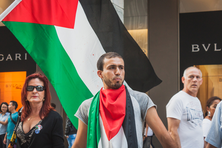 bombing: MILAN, ITALY - JULY 30: People protest against Gaza strip bombing in solidarity with Palestinians on JULY 30, 2014 in Milan.