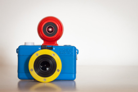 MILAN, ITALY - AUGUST 7, 2014  Closeup of Fisheye Baby 110 Bauhaus camera produced by Lomography, commercial trademark of Lomographische AG, an Austrian company famous for its analog cameras and accessories