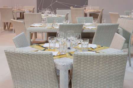 MILAN, ITALY - SEPTEMBER 13: Restaurant table at HOMI, home international show and point of reference for all those in the sector of interior design on SEPTEMBER 13, 2014 in Milan.