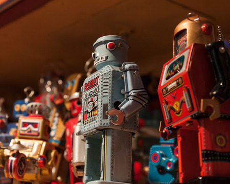 tinplate: MILAN, ITALY - SEPTEMBER 13: Vintage tinplate robots on display at HOMI, home international show and point of reference for all those in the sector of interior design on SEPTEMBER 13, 2014 in Milan. Editorial