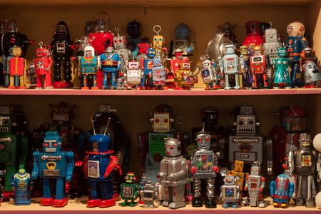 MILAN, ITALY - SEPTEMBER 13: Vintage tinplate robots on display at HOMI, home international show and point of reference for all those in the sector of interior design on SEPTEMBER 13, 2014 in Milan. Editorial