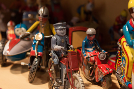 tinplate: MILAN, ITALY - SEPTEMBER 13: Vintage tinplate toys on display at HOMI, home international show and point of reference for all those in the sector of interior design on SEPTEMBER 13, 2014 in Milan.