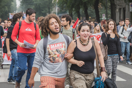 occupy movement: MILAN, ITALY - OCTOBER 10: Thousands of students march in the city streets to protest agaist the money cuts in the public school on OCTOBER 10, 2014 in Milan.