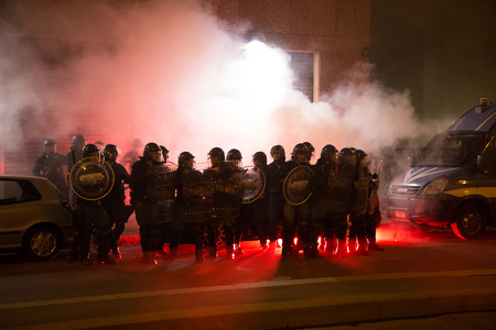 consulate: MILAN, ITALY - OCTOBER 11: Demonstrators launch smoke canisters to police in front of the Turkish consulate while asking help for Kurdish people in Syria on OCTOBER 11, 2014 in Milan. Editorial