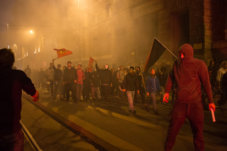 MILAN, ITALY - OCTOBER 11: Demonstrators launch smoke canisters to police in front of the Turkish consulate while asking help for Kurdish people in Syria on OCTOBER 11, 2014 in Milan. Editorial