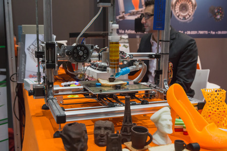 MILAN, ITALY - OCTOBER 22: 3d printer printing chocolate cup at Smau, international exhibition of information communications technology on OCTOBER 22, 2014 in Milan.