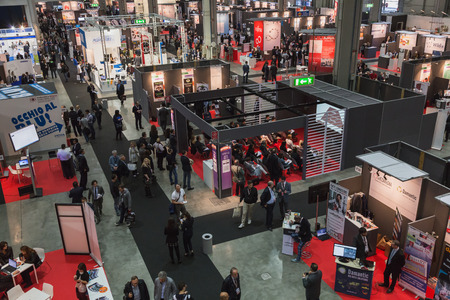 MILAN, ITALY - OCTOBER 22: Top view of people and booths at Smau, international exhibition of information communications technology on OCTOBER 22, 2014 in Milan.