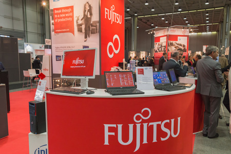 MILAN, ITALY - OCTOBER 22: Fujitsu stand at Smau, international exhibition of information communications technology on OCTOBER 22, 2014 in Milan. Publikacyjne