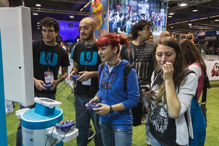 wii: MILAN, ITALY - OCTOBER 24: People play at Games Week 2014, event dedicated to video games and electronic entertainment on OCTOBER 24, 2014 in Milan. Editorial