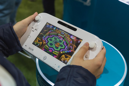 wii: MILAN, ITALY - OCTOBER 24: Detail of Nintendo Wii at Games Week 2014, event dedicated to video games and electronic entertainment on OCTOBER 24, 2014 in Milan.