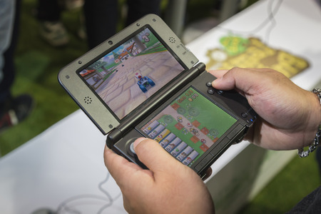 MILAN, ITALY - OCTOBER 24: Detail of Nintendo handheld console at Games Week 2014, event dedicated to video games and electronic entertainment on OCTOBER 24, 2014 in Milan.