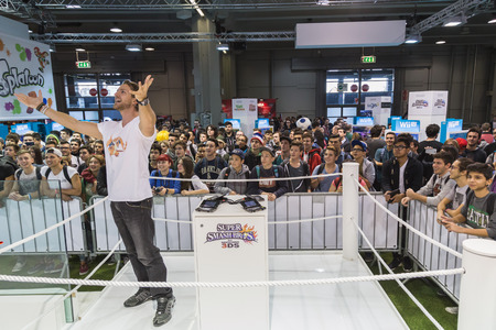nintendo: MILAN, ITALY - OCTOBER 24: People visit Nintendo stand at Games Week 2014, event dedicated to video games and electronic entertainment on OCTOBER 24, 2014 in Milan.