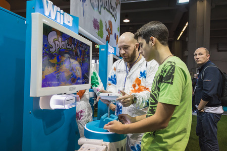 MILAN, ITALY - OCTOBER 24: People play at Games Week 2014, event dedicated to video games and electronic entertainment on OCTOBER 24, 2014 in Milan.