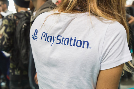 MILAN, ITALY - OCTOBER 24: Playstation t-shirt at Games Week 2014, event dedicated to video games and electronic entertainment on OCTOBER 24, 2014 in Milan.