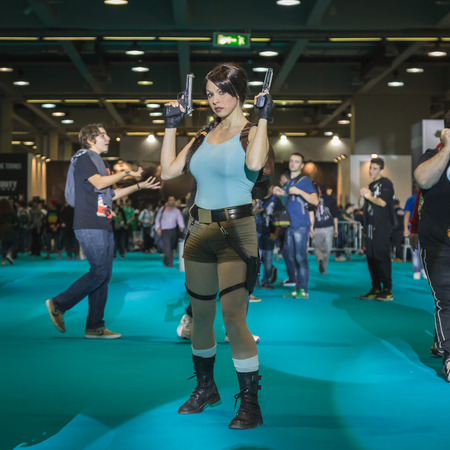 croft: MILAN, ITALY - OCTOBER 24: Lara Croft cosplayer poses at Games Week 2014, event dedicated to video games and electronic entertainment on OCTOBER 24, 2014 in Milan.