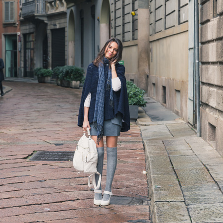 Beautiful girl with long hair posing in the city streets photo