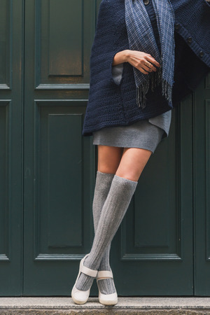 cute shoes: Detail of a beautiful girl with miniskirt posing in the city streets