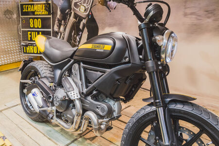 scrambler: MILAN, ITALY - NOVEMBER 5: Ducati Scrambler motorbike on display at EICMA, international motorcycle exhibition on NOVEMBER 5, 2014 in Milan. Editorial