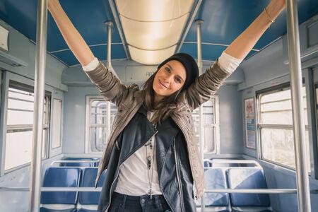 beanie: Pretty girl with beanie posing in a metro car