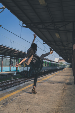 female clothing: Pretty girl with beanie posing in a metro station Stock Photo