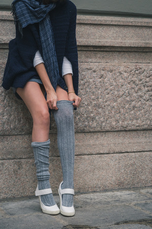 miniskirt: Detail of a beautiful girl with miniskirt posing in the city street