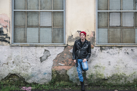 6e71eaeb962 Punk Guy With Beanie Posing In The City Streets Stock Photo