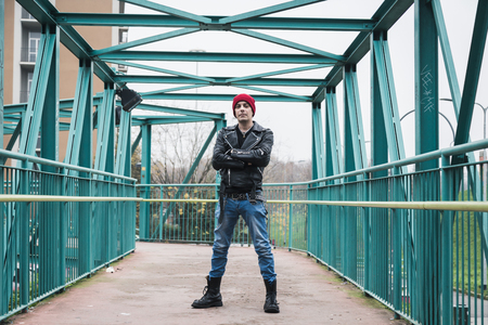 punk: Punk guy with beanie posing in the city streets Stock Photo