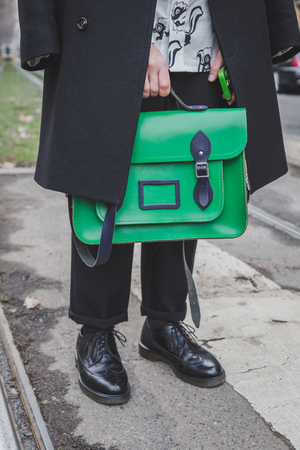 gucci: MILAN, ITALY - JANUARY 19: Detail of a bag outside Gucci fashion show building for Milan Mens Fashion Week on JANUARY 19, 2015 in Milan.