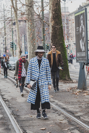 gucci: MILAN, ITALY - JANUARY 19: People gather outside Gucci fashion show building for Milan Mens Fashion Week on JANUARY 19, 2015 in Milan. Editorial