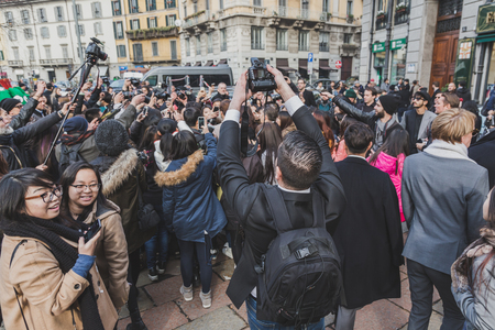 gucci: MILAN, ITALY - JANUARY 19: Crowd outside Gucci fashion show building for Milan Mens Fashion Week on JANUARY 19, 2015 in Milan. Editorial