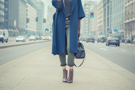 Detail of a stylish young woman posing in the city streets Stock Photo