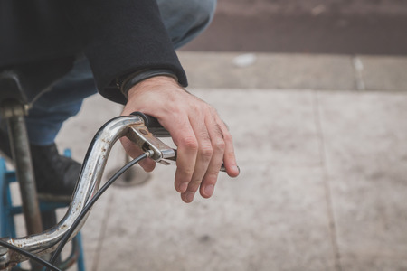 hand brake: Detail of a young man posing with his bicycle in the city streets Stock Photo