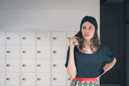 turban: Beautiful young brunette with turban posing in an office