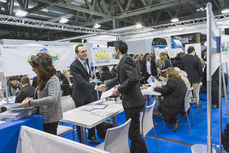 reference point: MILAN, ITALY - FEBRUARY 13: People visit Bit, international tourism exchange reference point for the travel industry on FEBRUARY 13, 2015 in Milan.