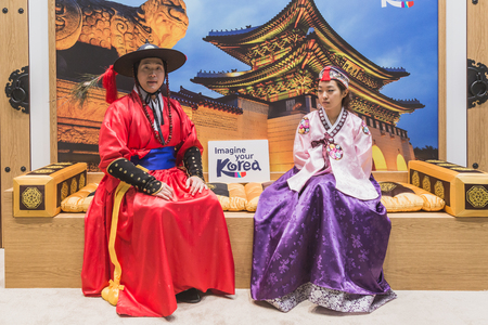 reference point: MILAN, ITALY - FEBRUARY 13: Korean people in traditional dresses at Bit, international tourism exchange reference point for the travel industry on FEBRUARY 13, 2015 in Milan.