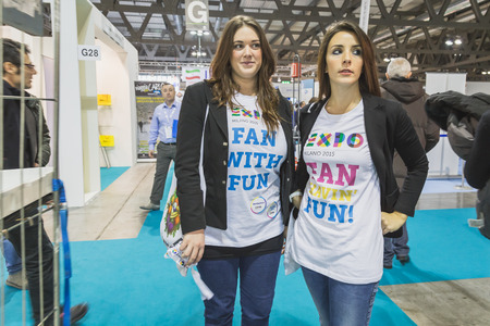 reference point: MILAN, ITALY - FEBRUARY 13: Girls wearing Expo t-shirt at Bit, international tourism exchange reference point for the travel industry on FEBRUARY 13, 2015 in Milan.